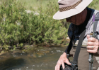 Lawrence Anderson measures the stream's velocity June 23. PHOTO BY HANNAH KEARSE