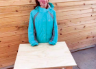 It's a family affair. Davies' daughter Reagan helps her dad create the desks. PHOTO COURTESY DENNIS DAVIES