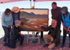 "NorthWestern Energy commissioned the ""Restoring Our Waters"" artwork to celebrate the success of the O'Dell Creek restoration project. Left to right, kneeling, NorthWestern Energy Director Environmental & Lands Permitting & Compliance Mary Gail Sullivan and renowned Montana artist Monte Dolack. Left to right, standing, Madison Farm to Fork Chair Kaye Suzuki, Granger Ranches owner Jeff Laszlo, NorthWestern Energy Chief Executive Officer Bob Rowe and Madison Farm to Fork GROWW Coordinator Janet BeanDochnahl."