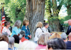 Governor Greg Gianforte addresses a crowd of Madison Valley Woman's Club members and supporters at Peter T's Park in Ennis, commending the club for its significant role in the community. PHOTO BY JOLENE PALMER