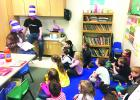 Sandy Moore & Zane Bowey read Horton Hatches the Egg to the Kindergarten class.