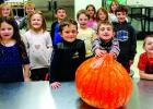 Students from Jessie Rice's first-grade class, with the help of some high school culinary arts students, turned a huge, homegrown winter squash into soup last week as part of the Montana Harvest of the Month Program. (Jamie Diehl)