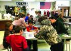 """Seventh grade students at Ennis Schools cooked and ate six different varieties of Montana-grown grains for the March Harvest of the Month program, making """"Green Grain Grub,"""" a grain salad with a pesto dressing. (J. Diehl)"""